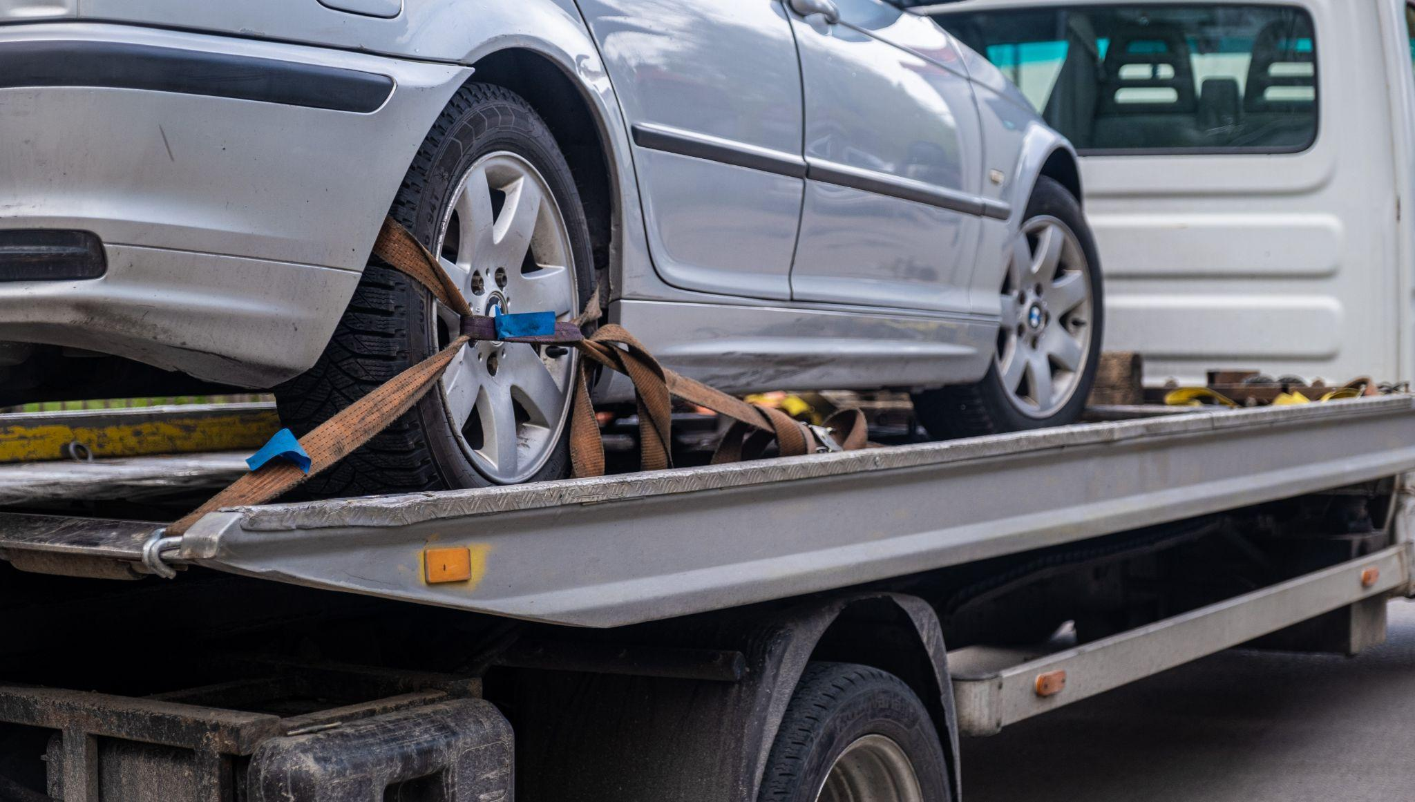 A car being repossessed by a repossession agency, something that an auto repossession attorney at The Law Offices of Kevin T. Simon, APC can help you with.